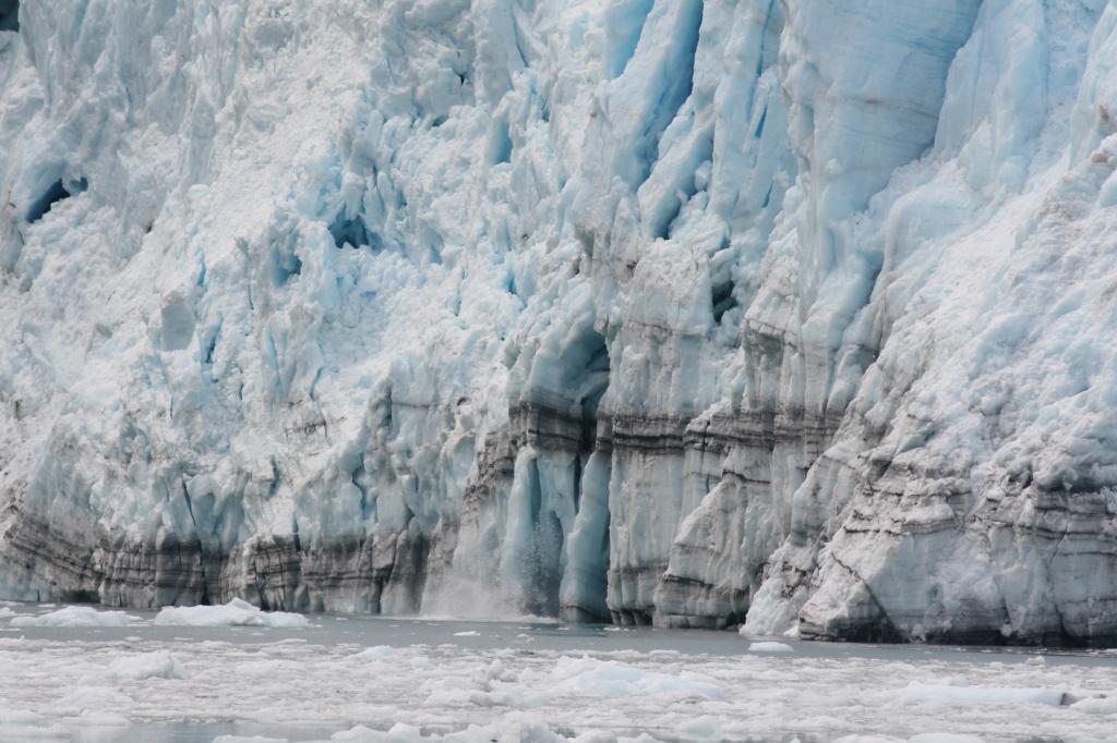 Glacier ice falling into the sea